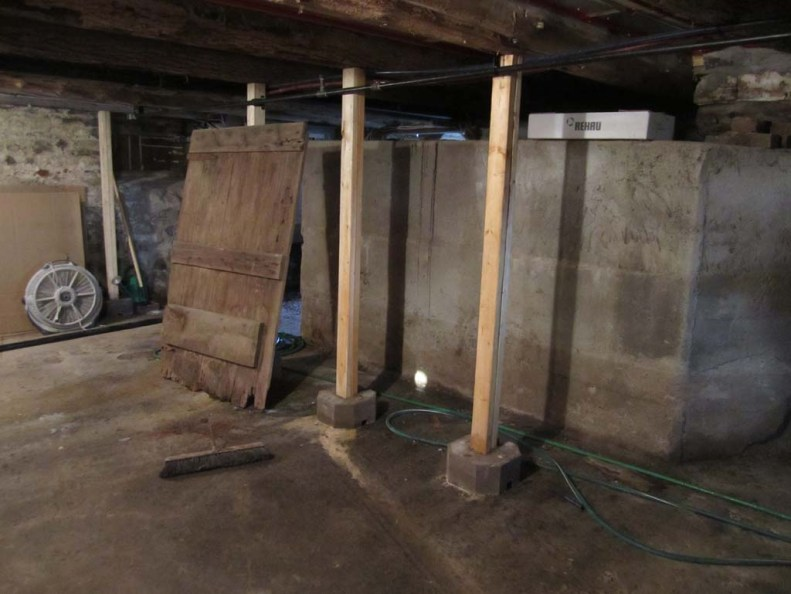 Picture shows a stone cistern for water storage in a 19th century house in Prince Edward County.