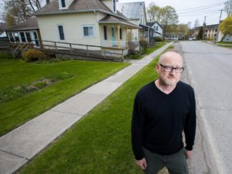 Photo from Toronto Star article on the shortage of affordable housing due to short-term rentals showing single parent Craig Foster.