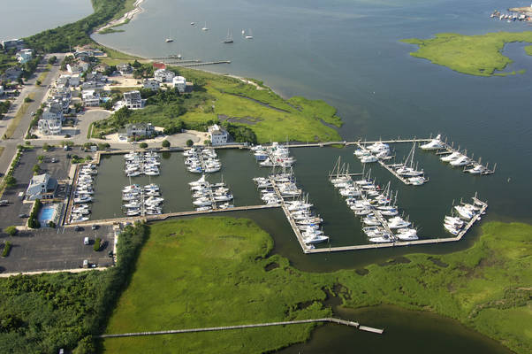 Image shows aerial view of a dockominium near the Atlantic Ocean where prices double as soon as the last dock was sold.