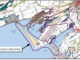 Chart from 2021 Official Plan shows how most of the area around Sandbanks Provincial Park is designated as a Natural Core Area where development is prohibited.